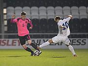 Scotland's Jamie McCart evades the challenge of Estonia's Rauno Sappinen - Scotland under 21s v Estonia international challenge match at St Mirren Park, St Mirren. Pic David Young<br />  <br /> - © David Young - www.davidyoungphoto.co.uk - email: davidyoungphoto@gmail.com