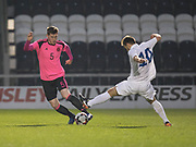 Scotland's Jamie McCart evades the challenge of Estonia's Rauno Sappinen - Scotland under 21s v Estonia international challenge match at St Mirren Park, St Mirren. Pic David Young<br />  <br /> - &copy; David Young - www.davidyoungphoto.co.uk - email: davidyoungphoto@gmail.com