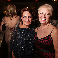 Barbara Fox, left, and Halina Williams-Dabby pose for a picture Saturday December 6, 2014 during the 9th Annual Wilmington Fur Ball at the Country Club of Landfall in Wilmington, N.C. (Jason A. Frizzelle)