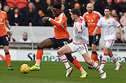 Pelly Ruddock-Mpanzu (17) Luton Town FC defender  and Jordan Houghton (16) Doncaster Rovers midfielder during the EFL Sky Bet League 2 match between Doncaster Rovers and Luton Town at the Keepmoat Stadium, Doncaster, England on 18 February 2017. Photo by Ian Lyall.