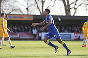 AFC Wimbledon striker Lyle Taylor (33) scores a goal 1-1 equalises and celebrates during the EFL Sky Bet League 1 match between AFC Wimbledon and Millwall at the Cherry Red Records Stadium, Kingston, England on 2 January 2017. Photo by Stuart Butcher.