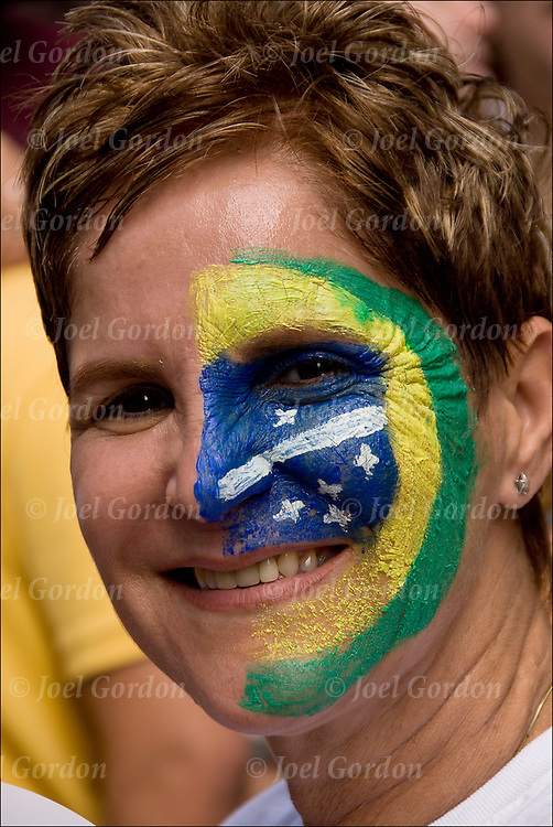 Portrait of Brazilian American with Brazilian flag painted on her face at the 25th Annual Brizilian Independence Day is a celebration.