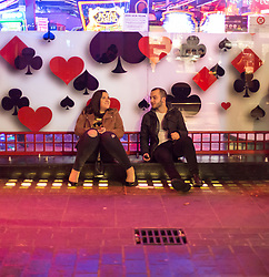 London, January 01 2018. A couple rest in Chinatown as revellers in London's West End enjoy New Year's Eve. © SWNS