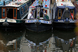 © Licensed to London News Pictures. 06/05/2013, London, UK.  Boaters read on their canal boat during the Canalway Cavalcade waterway festival at Little Venice in London, Monday, May 6, 2013. Photo credit : Sang Tan/LNP