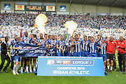 Wigan lift the League 1 trophy after the Sky Bet League 1 match between Wigan Athletic and Barnsley at the DW Stadium, Wigan, England on 8 May 2016. Photo by John Marfleet.