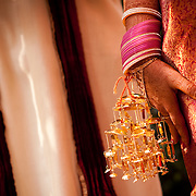 Bangles and gold decorations on the hands of an Indian bride during a Hindu wedding in Delhi.