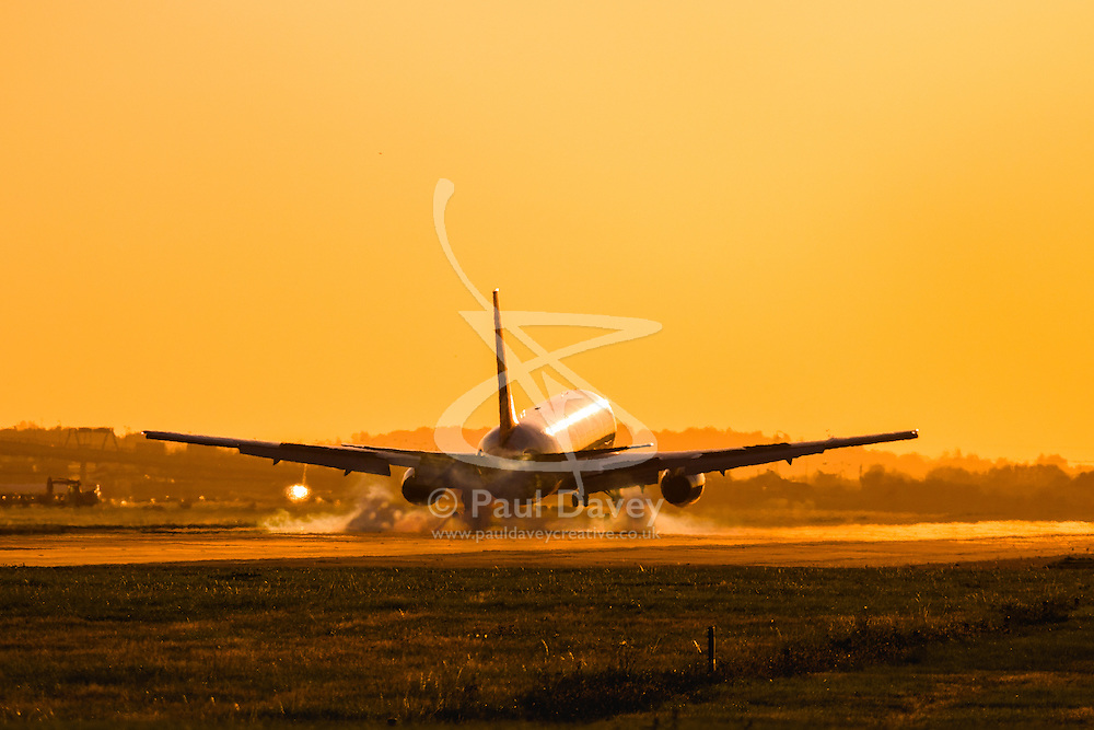 A Boeing 777 lands on runway 27R at London's Heathrow Airport (LHR / EGLL).