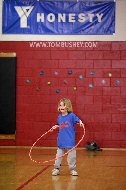 Middletown, New York - A girl plays with a hula hoop at Family Night at the Middletown YMCA on April 2, 2011.