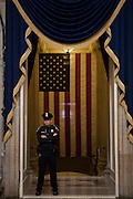 A Capitol Police Officer guards the path to the swearing-in before the presidential inauguration, January 21, 2013.