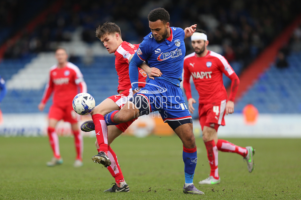 Aaron Amadi-Holloway of Oldham Athletic and Charlie Raglan of Chesterfield battle for the ball during the Sky Bet League 1 match between Oldham Athletic and Chesterfield at Boundary Park, Oldham, England on 28 March 2016. Photo by Simon Brady.