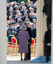 © London News Pictures. 28/06/2012.  London, UK. War veterans watch as HRH Queen Elizabeth II unveils a new £3.5m Bomber Command Memorial in Green Park, London dedicated to the 55,573 airmen who died in the Second World War. The pavilion, made of Portland Stone stands at over 8m tall with an open roof. The entrance is made from melted down aluminium sections of a Halifax bomber shot down during the war and in which all seven of the crew were killed. The memorial includes inscriptions from Winston Churchill. Photo credit: Ben Cawthra/LNP