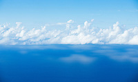 Sky, clouds and the Pacific Ocean reflecting the clouds above as seen from Kalalau Valley overlook, Kauai, Hawaii on the Napali Coast