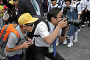 photographer working making school group portraits with young boy anticipating Japan