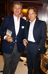 Left to right, ARNAUD BAMBERGER and the EARL OF MARCH at a party to celebrate the publication of Racing Style at Ralph Lauren, 1 New Bond Street, London on 8th September 2005.<br />