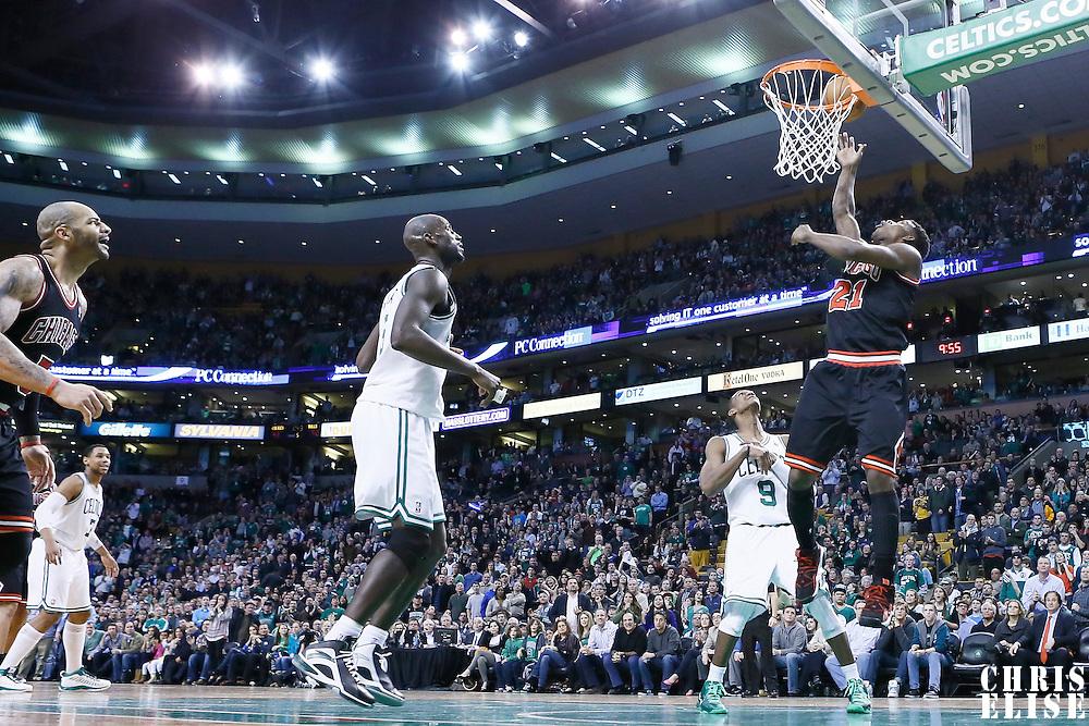 18 January 2013: Chicago Bulls small forward Jimmy Butler (21) scores on the alley hoop during the Chicago Bulls 100-99 overtime victory over the Boston Celtics at the TD Garden, Boston, Massachusetts, USA.