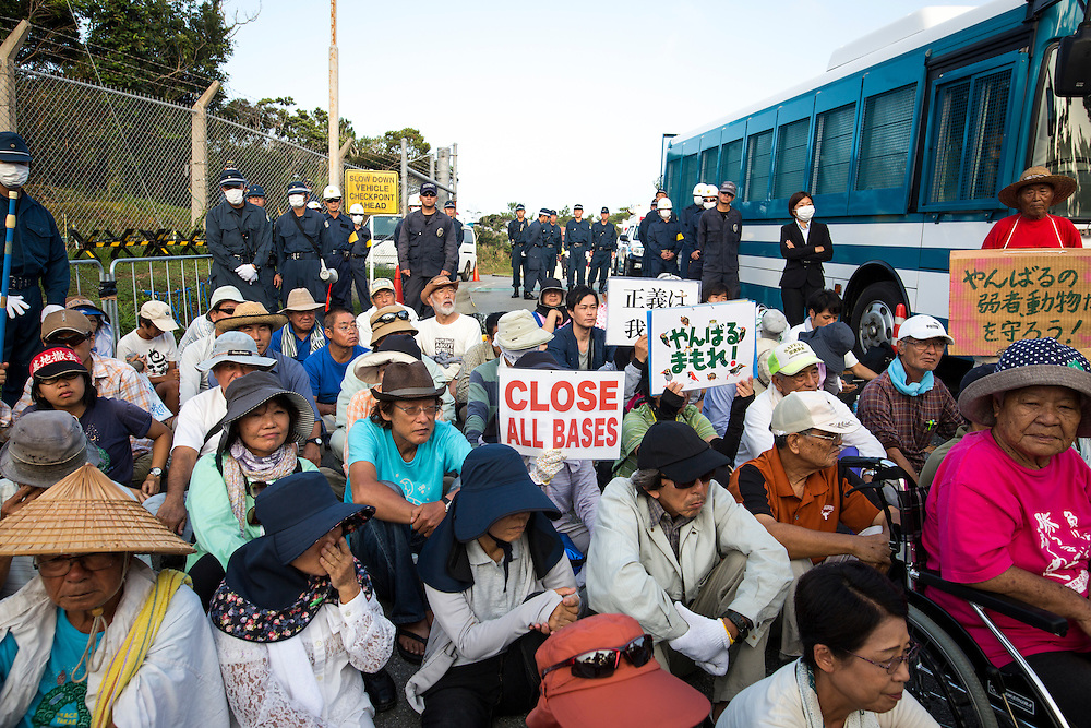 OKINAWA, JAPAN - AUGUST 19 : Anti U.S base protesters staged a sit-in protest against the construction of helipads in front of the main gate of U.S. military's Northern Training Area in the village of Higashi, Okinawa Prefecture, on August 19, 2016. Japanese government resume construction of total six helipads in a fragile ten million year old Yanbaru forest that is home to endemic endangered species such as the Okinawan rail and Okinawa wood pecker. (Photo by Richard Atrero de Guzman/NURPhoto)