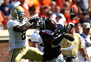 Charlottesville, VA :  Georgia Tech's Demaryius  Thomas pulls the helmet off of a corner back during their game at University of Virginia's on Saturday in Charlottesville,VA. ©2008 Johnny Crawford