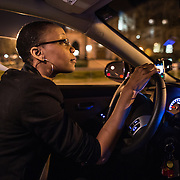 WASHINGTON, DC - APR 4:  UberX driver, Regan Rucker, works a busy Friday night April 4, 2014, in downtown Washington, DC. Rucker, a single mom who recently started driving for UberX, likes the flexibility of UberX because she can work whenever and however long she wants.<br /> <br /> Thousands of local car owners have signed up in recent months to drive with one of the &quot;ride-share&quot; operators that use smartphone apps to link people needing rides with car owners willing to give them, for a price. (Photo by Evelyn Hockstein/For The Washington Post)