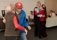 Les and Lee Pleeter of Gilford and Tony and Carolyn Truell of Meredith get into the swing of things at the Gilford Parks and Recreation hosted Senior Momentum Valentine Dance Monday afternoon at the Fellowship Hall of the Gilford Community Church.  (Karen Bobotas/for the Laconia Daily Sun)