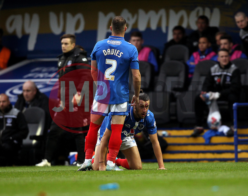 Blood pours from the head of Christian Burgess of Portsmouth - Mandatory byline: Robbie Stephenson/JMP - 07966 386802 - 15/11/2015 - Rugby - Fratton Park - Portsmouth, England - Portsmouth v AFC Wimbledon - Sky Bet League Two