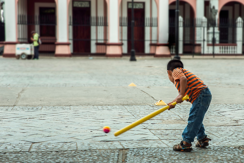 Boy plays in Central Plaza, in Granada, Nicaragua. Copyright 2017 Reid McNally.