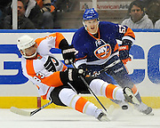 Philadelphia Flyers right wing Nikolay Zherdev and New York Islanders right wing Blake Comeau battle for the puck during an NHL hockey game at the Nassau Coliseum in Uniondale, N.Y. (AP Photo/Kathy Kmonicek)