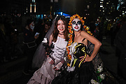 New York, NY - 31 October 2019. the annual Greenwich Village Halloween Parade along Manhattan's 6th Avenue. A woman and a girl vamp for the camera.