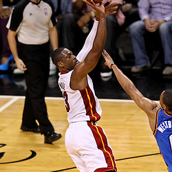 Jun 19, 2012; Miami, FL, USA; Miami Heat shooting guard Dwyane Wade (3) shoots over Oklahoma City Thunder point guard Russell Westbrook (0) during the second quarter in game four in the 2012 NBA Finals at the American Airlines Arena. Mandatory Credit: Derick E. Hingle-US PRESSWIRE