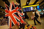 'Glorious Britain' Union Jack flags in retail shop at Heathrow's Terminal 5.