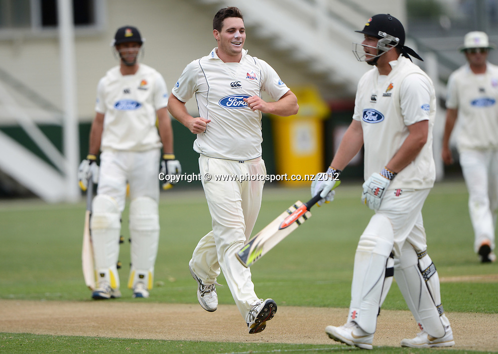 Auckland bowler Mitchell McClenaghan takes the wicket of Jesse Ryder. Plunket Shield Cricket, Auckland Aces v Wellington Firebirds at Eden Park Outer Oval. Auckland on Monday 26 November 2012. Photo: Andrew Cornaga/Photosport.co.nz