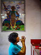 21 AUGUST 2018 - GEORGE TOWN, PENANG, MALAYSIA: A woman prays in Kuan Yin Temple. Kuan Yin Temple is the oldest Chinese temple in George Town, Penang.     PHOTO BY JACK KURTZ