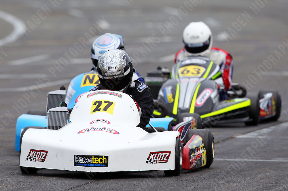 Andrew Hoare, 27, Gareth Playle, NZ, and Mason Armstrong, 63, race in the Rotax Light class during the 2012 Superkart National Champs and Grand Prix at Manfeild in Feilding, New Zealand on Saturday, 7 January 2011. Credit: Hagen Hopkins.