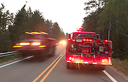 One of the Department of Natural Resources trucks from the Baraga area (right) heads out into the Sleeper Lake forest fire for the night shift as trucks from other areas make thier way in after fighting the fire during the day. The fire that is north of Newberry in the upper peninsula has been buirning an average of 5,000 acres a day.