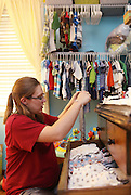 Melissa Kennedy packs up a variety of clothing items Thursday at her home in Vina for when she goes to the hospital to have her baby. She lives too great of a distance from the hospital where she will give birth to just stop back by her home and must prepare for everything beforehand.
