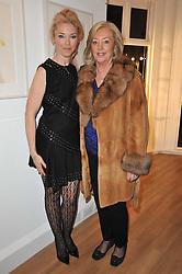 Left to right, TAMARA BECKWITH and her mother PAULA BECKWITH at a party to launch Alistair Taylor-Young's new book 'The Phone Book' held at The Little Black Gallery, 13A Park Walk, London SW10 on 18th January 2011.