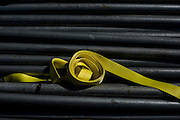 Philadelphia, Pennsylvania - September 17, 2015: A tie down strap sits on plan bars used for media platform scaffolding towers.<br /> <br /> Scott Mirkin's company ESM is heading the production of The World Meeting Of Families and Pope Francis's visit to Philadelphia this Fall. The events will take place along the Benjamin Franklin Parkway.<br /> <br /> CREDIT: Matt Roth for The New York Times<br /> Assignment ID: 30179397A