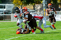 KELOWNA, CANADA - SEPTEMBER 16: Andre Gordon #11 of the Vancouver Island Raiders is tackled by the Okanagan Sun on September 16, 2018, at the Apple Bowl, in Kelowna, British Columbia, Canada.  (Photo by Marissa Baecker/Shoot the Breeze)  *** Local Caption ***