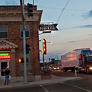 Heavy trucks roll through main street in downtown Sydney, Montana, one of the small towns being overrun by the biggest oil boom in America. The Bakken oil boom is redrawing North Dakota and Montana's landscape, and creating opportunity for thousands of unemployed Americans. However, the economic prosperity has exacerbated problems in housing, infrastructure and traffic...Known for the beauty of its great plains, North Dakota has long been the least populated state in the country. Because of the Bakken oil boom, everyday, mostly men, pour in from across the nation looking for work. The small town of Williston has exploded as a result. Ten years ago Williston, North Dakota was a quiet agricultural town with a population around 12,000. In a decade the population has more than doubled to over 30,000. More than half of Williston's residents now work in oil-related jobs and the city's unemployment rate is at 1 percent, which is the lowest in the U.S...