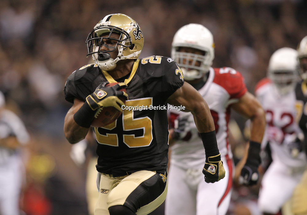 16 January 2010:  New Orleans Saints running back Reggie Bush (25) runs with the ball for a touchdown against the Arizona Cardinals during the first half of the 2010 NFC Divisional Playoff game at the Louisiana Superdome in New Orleans, Louisiana.