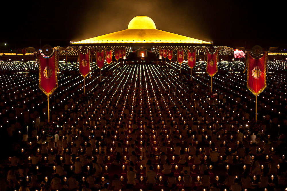 Devotees of the Dhammakaya Buddhist movement founded in Thailand pray during Makha Bucha day at Wat Phra Dhammakaya  on the outskirts of Bangkok, Thailand Wednesday, March 7, 2012.