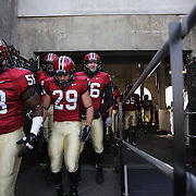 Harvard players prepare to enter the field of play during the Harvard Vs Yale, College Football, Ivy League deciding game, Harvard Stadium, Boston, Massachusetts, USA. 22nd November 2014. Photo Tim Clayton