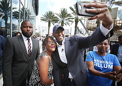 October 4, 2018 - Orlando, FL, USA - Andrew Gillum, candidate for Florida governor, takes selfies with supporters during an appearance on Thursday, Oct. 4, 2018 at the Amway Center in Orlando, Fla. (Credit Image: © Stephen M. Dowell/Orlando Sentinel/TNS via ZUMA Wire)