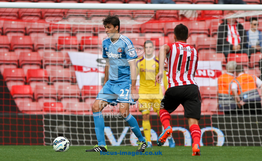 Santiago Vergini (left) of Sunderland in possession of the ball during the Barclays Premier League match at the St Mary's Stadium, Southampton<br /> Picture by Tom Smith/Focus Images Ltd 07545141164<br /> 18/10/2014