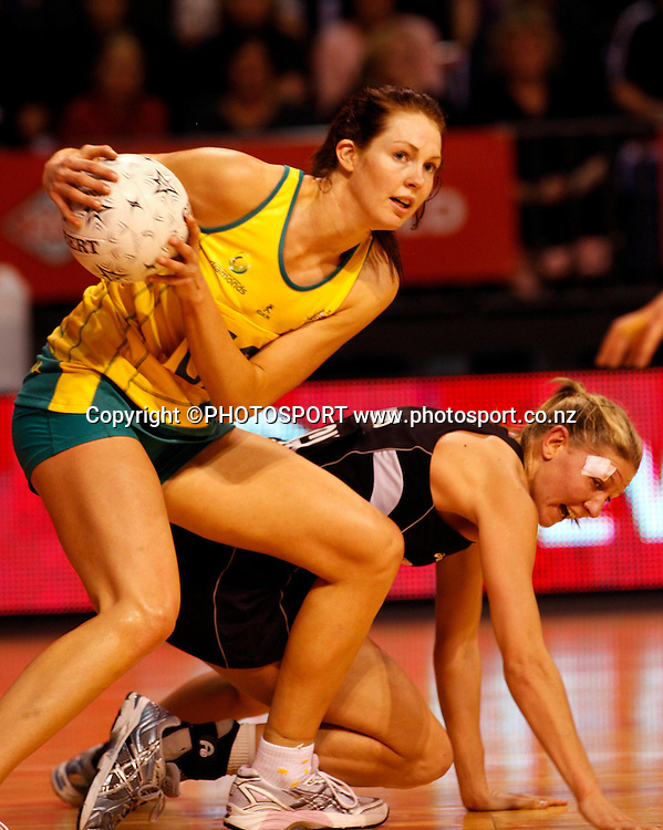 Australia GS Kate Beveridge gets to the ball ahead of Casey Williams.<br />