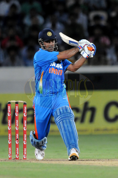 Mahendra Singh Dhoni captain of India  bats during the first One Day International ( ODI ) match between India and England held at the Rajiv Gandhi International Stadium, Hyderabad on the 14th October 2011..Photo by Pal Pillai/BCCI/SPORTZPICS