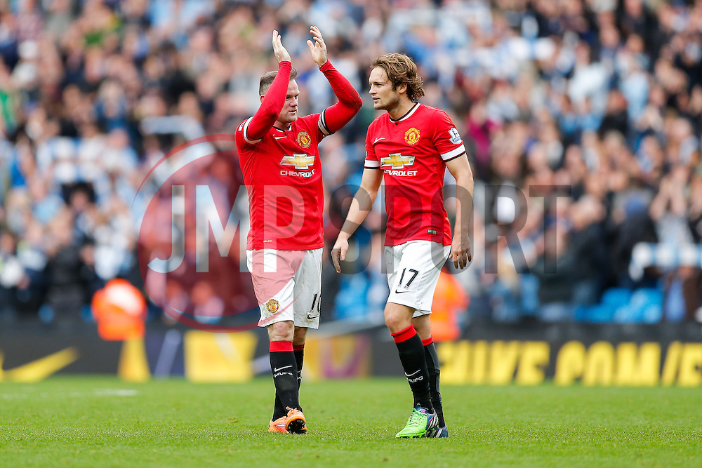 Wayne Rooney claps the away fans as Daley Blind of Manchester United looks dejected after Manchester City win the game 1-0 - Photo mandatory by-line: Rogan Thomson/JMP - 07966 386802 - 02/11/2014 - SPORT - FOOTBALL - Manchester, England - Etihad Stadium - Manchester City v Manchester United - Barclays Premier League.