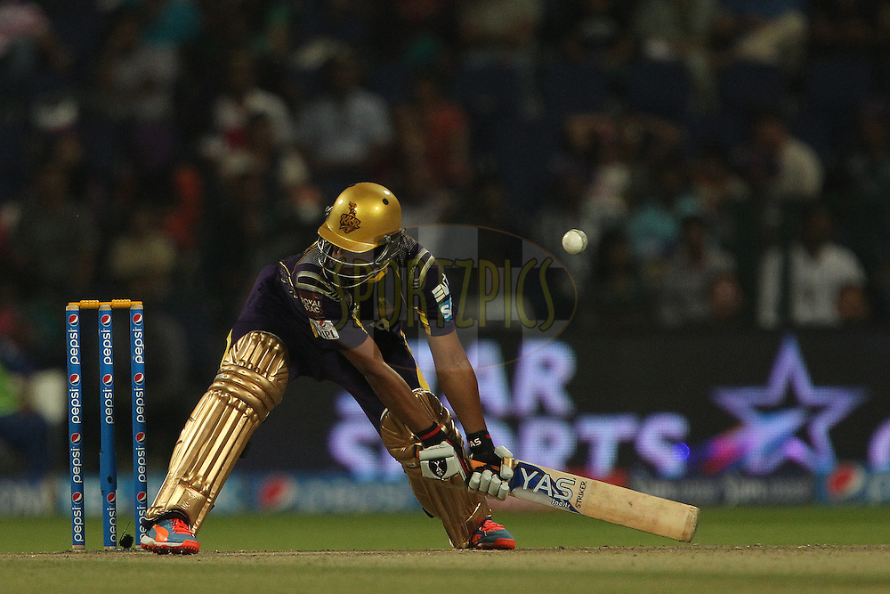 Shakib Al Hasan of the Kolkata Knight Riders tries to lift the ball over the top but it hits his helmet during match 19 of the Pepsi Indian Premier League 2014 Season between The Kolkata Knight Riders and the Rajasthan Royals held at the Sheikh Zayed Stadium, Abu Dhabi, United Arab Emirates on the 29th April 2014<br /> <br /> Photo by Ron Gaunt / IPL / SPORTZPICS