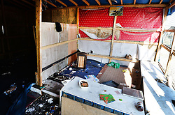 A recently deserted shop on the 'high street' in 'the jungle' near Calais, northern France, as the mass exodus from the migrant camp continues.