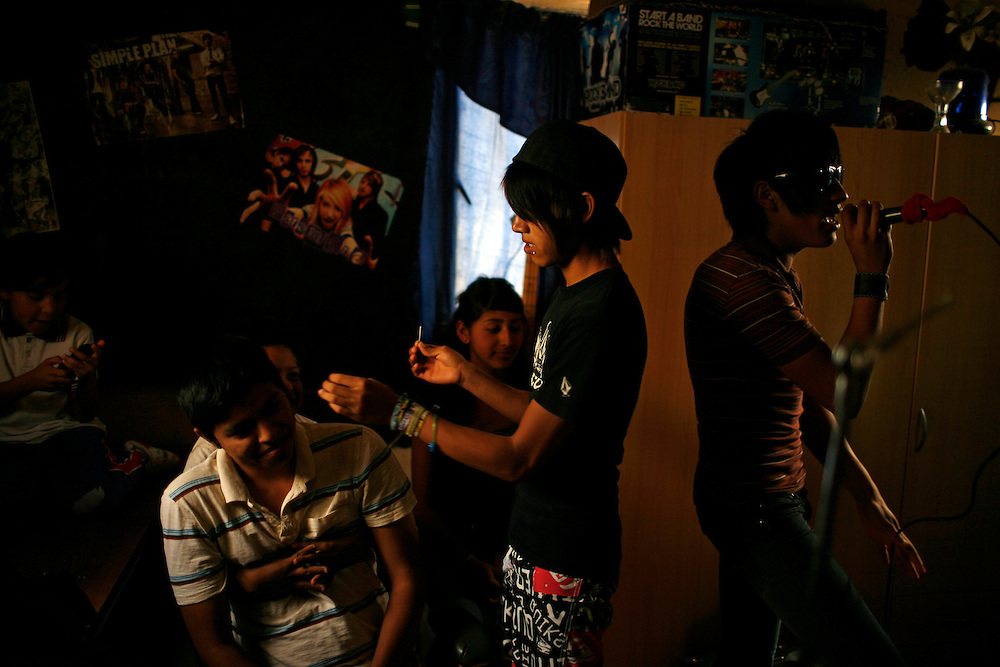 The Toke Azul rock band practices while one member attempts to pierce a friend in the Diaz Ordaz colonia in Ciudad Juarez, Chihuahua Mexico on April 28, 2010. ...