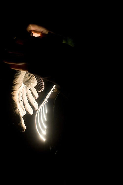 Photographer: Christophe Margot.Date: 4 July 2008.Athlete: Team Golgoht                              Description: Crew member of the Golgoht's team dry the gloves of Juha-Matti Pouta Location: Interlaken